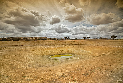 Dam in drought in farmer's barren field - p1125m2073232 by jonlove