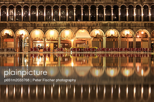 Procuratie Vecchie, the Caff̬ Quadri reflected in the high Water (Acqua alta) of St. Mark's Square, Venice, Veneto, Italy - p651m2033768 by Peter Fischer