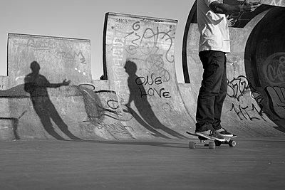 Skateboarders shadow on ramp - p1201m1050383 by Paul Abbitt