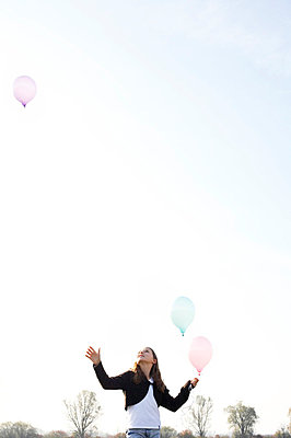 Girl with balloons - p5730026 by Birgid Allig
