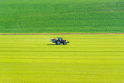 Farmer at work in his tractor - p813m1223517 by B.Jaubert