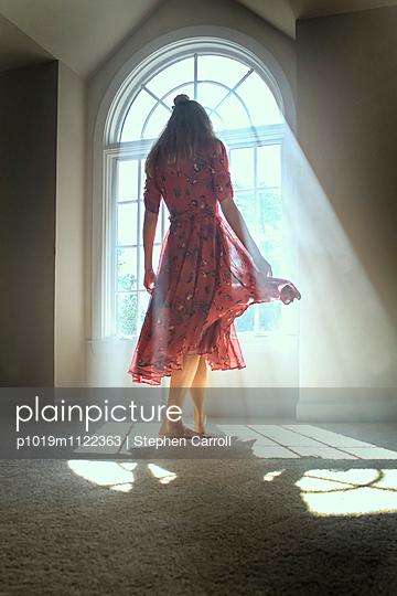 Dancing Girl in Smokey Light of Window  - p1019m1122363 by Stephen Carroll