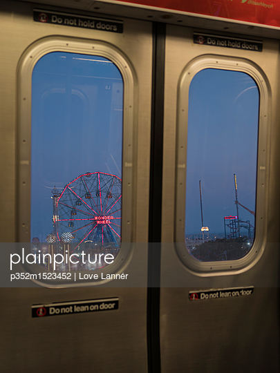 Rollercoaster behind subway doors in Coney Island, New York City - p352m1523452 by Love Lannér