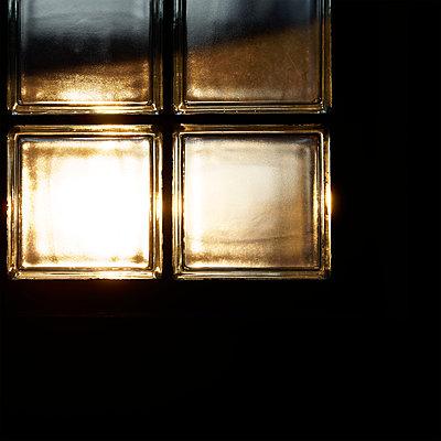 Glass blocks at twilight - p1578m2289303 by Marcus Hammerschmitt