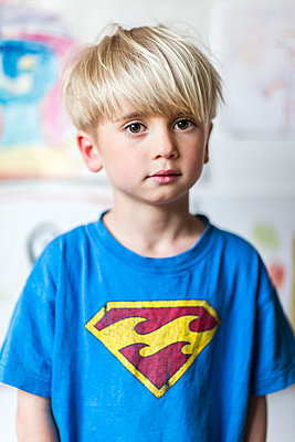 Portrait of boy in blue t-shirt - p312m1229231 by Peter Rutherhagen