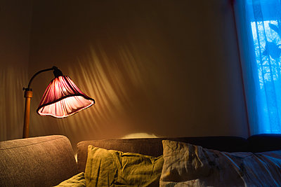 Floor lamp by sofa - p1418m1572276 by Jan Håkan Dahlström