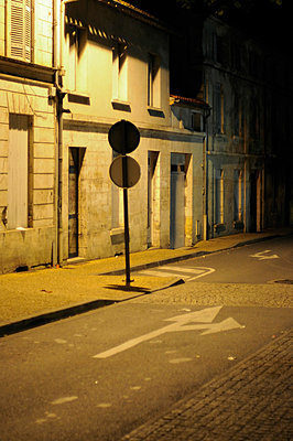 Deserted French street at night - p1072m829280 by Neville Mountford-Hoare