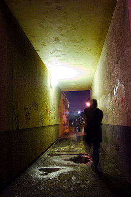 Man walking in a tunnel at night, Sweden. - p5282199 by Pontus Johansson