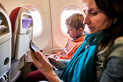 Mother and boy in airplane - p890m2099709 by Mielek