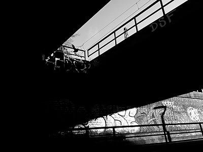 Graffiti under a bridge - p551m1585021 by Kai Peters