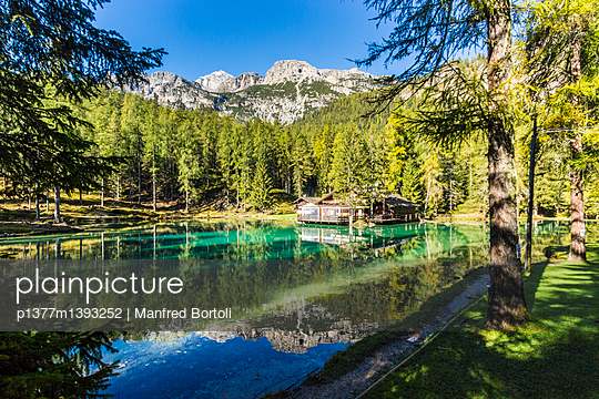 Clear waters of Ghedina Lake surrounded by pine - p1377m1393252 by Manfred Bortoli