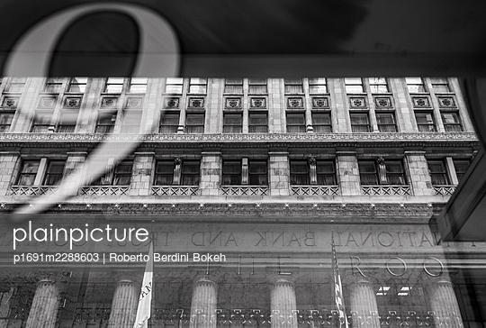 City National Bank and Trust Company reflection - p1691m2288603 by Roberto Berdini Bokeh
