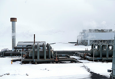Power plant in snowy landscape - p555m1415707 by Pete Saloutos