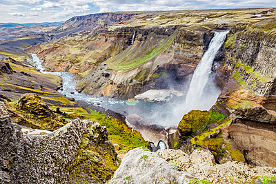 A high viewpoint of one of the waterfalls and rivers in the Haifoss valley with stunning cliffs, natural colors and rock formations; Iceland - p442m2008936 by Alanna Dumonceaux