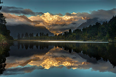 Sunset reflection of Lake Matheson with Mount Tasman and Mount Cook - p884m863963 by Colin Monteath/ Hedgehog House