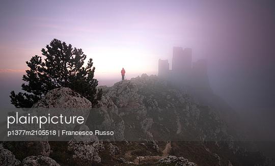 Italy, Abruzzo, L'Aquila district, Apennines, Appennini, Gran Sasso National Park, Calascio, Rocca Calascio Castle wrapped in the fog - p1377m2105518 by Francesco Russo