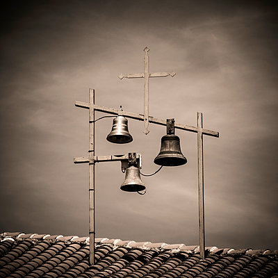 Bells and Crosses at the top of a church. Haute-Loire. France. - p813m1462110 by B.Jaubert