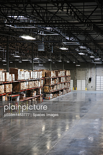 Cardboard boxes on shelves in warehouse