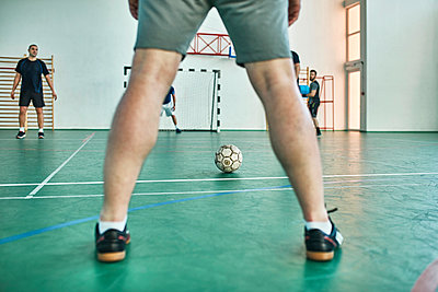 Men playing indoor soccer - p300m1587961 by Zeljko Dangubic