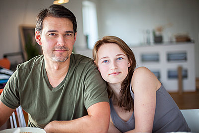 Father and teenage daughter, portrait - p312m1121782f by Christina Strehlow