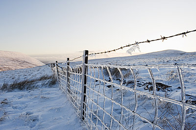Ice covered fence on Pen y Fan mountain, Brecon Beacons National Park, Powys, Wales, United Kingdom, Europe - p871m1073591f by Christian Kober