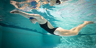 Young female swimmer during training - p1554m2272610 by Tina Gutierrez