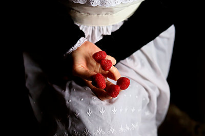 Chambermaid with raspberry on her fingers - p1521m2193355 by Charlotte Zobel