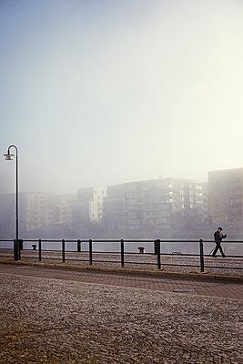 Buildings at water in fog - p312m1121473f by Dan Lepp