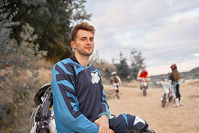 Motorbiker on motocross racing course - p1630m2206234 by Sergey Mironov