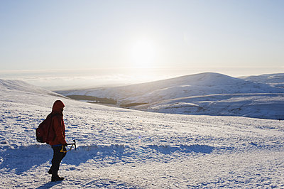Hiker on snow covered Pen y Fan mountain, Brecon Beacons National Park, Powys, Wales, United Kingdom, Europe - p871m1073590f by Christian Kober