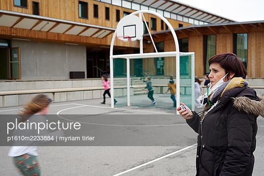 a school teacher gives a sport class in the recreation yard - p1610m2233884 by myriam tirler