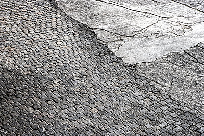 Cobblestone pavement and tarmac - p300m1206026 by Jo Kirchherr