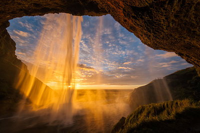 Sunset light shines through the water of Seljandefoss along the South coast; Iceland - p442m1482836 by Robert Postma