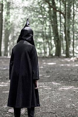 Boy in a hooded cape - p1228m2196106 by Benjamin Harte