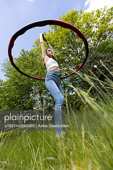 Hula hoop on the meadow - p1621m2283365 by Anke Doerschlen