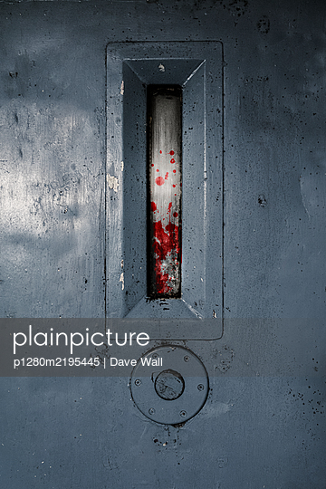 Prison cell door with blood on the spyhole - p1280m2195445 by Dave Wall