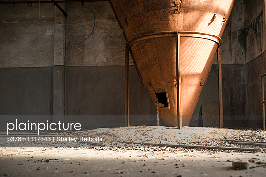 Machinery in abandoned grain store. France - p378m1117343 by Shelley Belboda