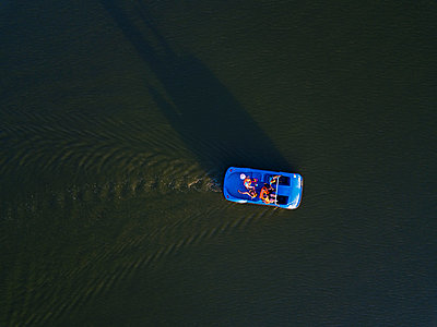 Blue pedal boat on the water, drone photography - p1108m2210621 by trubavin