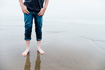 Rolled Denim Jeans at the Beach - p1262m1440875 by Maryanne Gobble