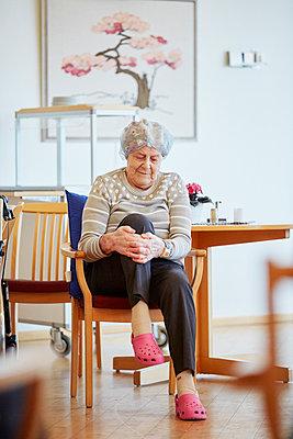 Senior woman stretching - p312m1054586f by Jan Tove