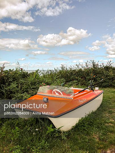 Small boat on land - p382m2284009 by Anna Matzen