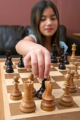 Girl playing chess - p4342462f by Marv Johnson