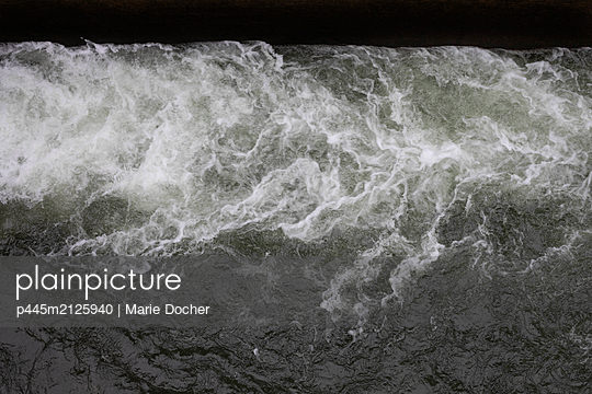 water in a floodgate - p445m2125940 by Marie Docher