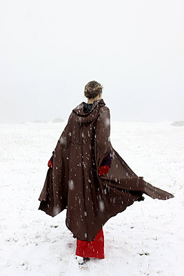 Woman in snow - p1019m2141654 by Stephen Carroll