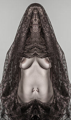 Symmetrical, constructed portrait of woman dressed in lace with bare breasts and two belly buttons. - p1433m2151381 by Wolf Kettler
