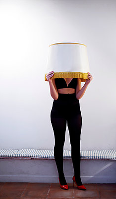 Woman and lamp shade - p1521m2129140 by Charlotte Zobel