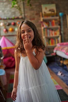 Girl in white summer dress in the nursery, portrait - p1640m2245858 by Holly & John