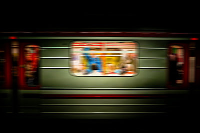 subway train running fast across a metro station  - p965m1529091 by VCreative