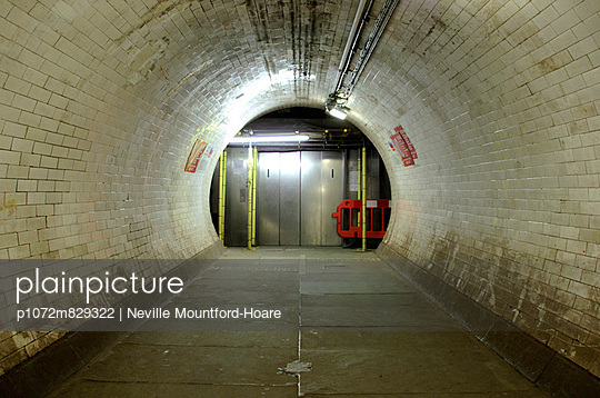 Elevator at the end of tiled foot tunnel - p1072m829322 by Neville Mountford-Hoare