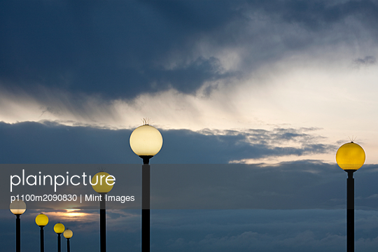 Street Lights at Dusk - p1100m2090830 by Mint Images